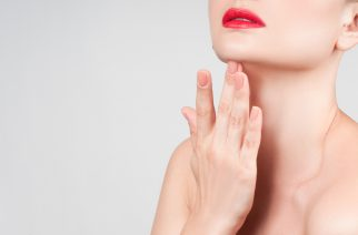 Beauty face. Beautiful woman neck with clean skin and red lips